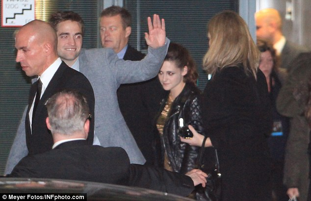 Gentleman: Robert still managed to wave at his fans as they made their great escape