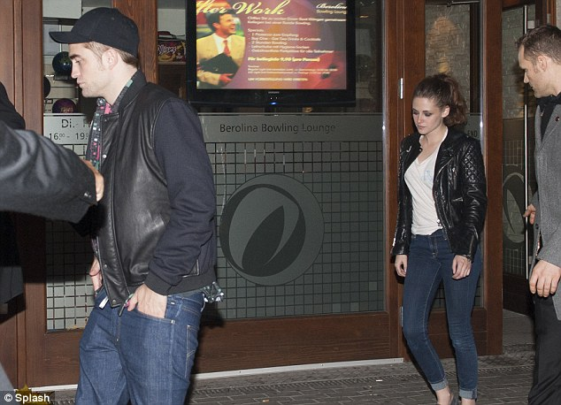 His 'n' hers: the duo both wore leather but Kristen wasn't wearing a cap like her beau as she is wont to do