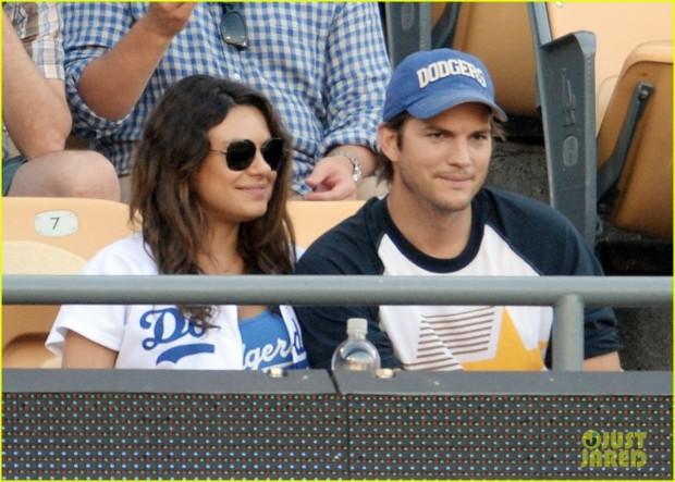 Mila Kunis and Ashton Kutcher kiss at LA Dogers v St Louis Cardinals, Los Angeles