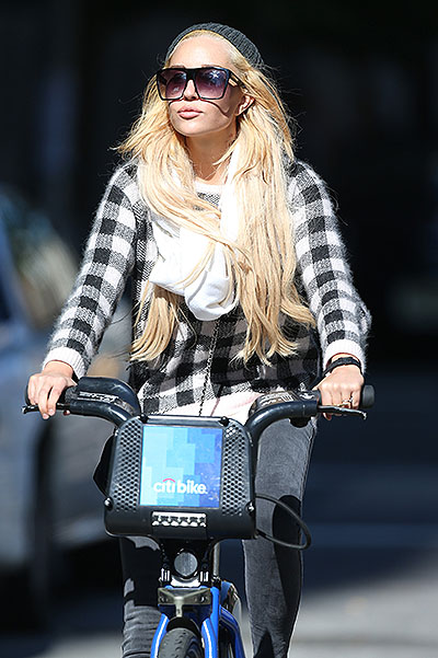 EXCLUSIVE: Amanda Bynes looking glamorous while riding a Citi Bike around the streets of New York