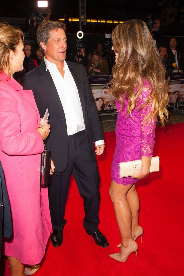 Elizabeth-Hurley-right-talks-to-Hugh-Grant-as-they-arrive-for-the-premiere-of-The-Rewrite-at-the-Odeon-Kensington-in
