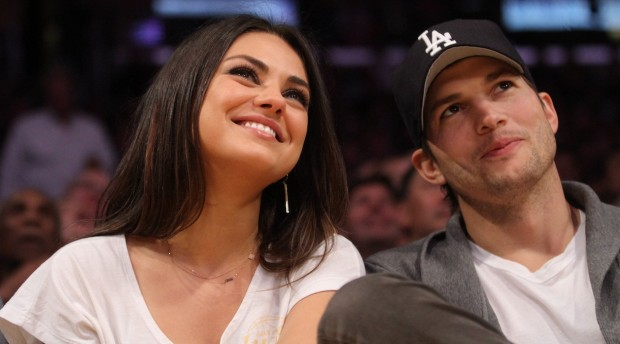 Ashton Kutcher and Mila Kunis are all smiles as they hang out at the Los Angeles Lakers Vs The Phoenix Suns at the Staples Center in Los Angeles, CA