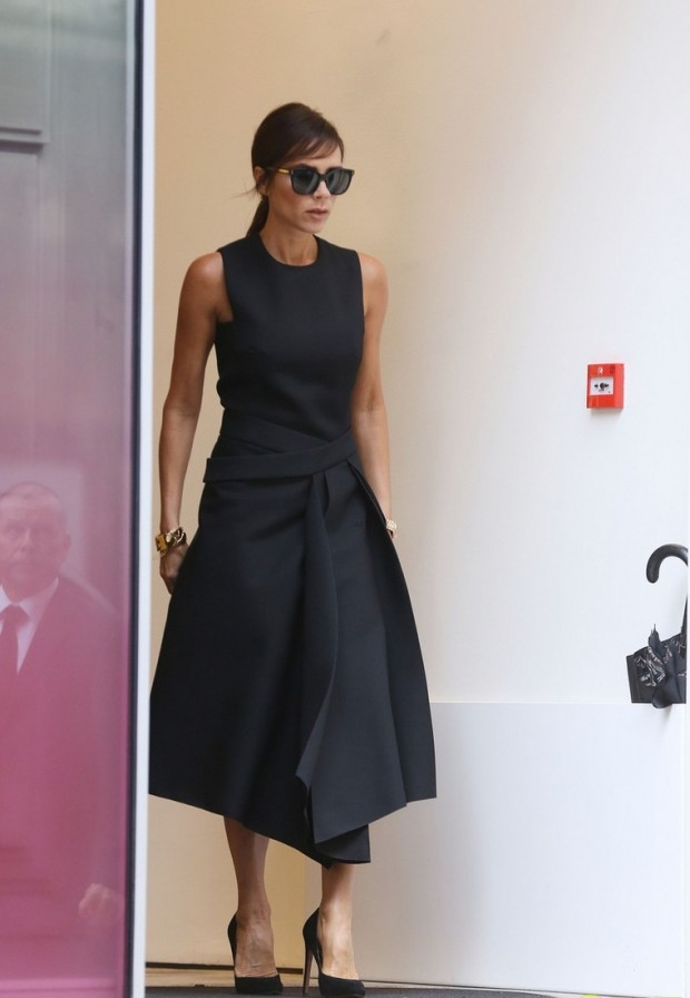 142008, EXCLUSIVE: Victoria Beckham shows off her new haircut as she steps out shopping in Central London. The 41-year-old debut her new fringe as she enjoyed a shopping spree on Sunday, looking remarkably like Audrey Hepburn, particularly with her massive shades on. The stylish mum-of-four also wore a black dress from her own collection as she hit the shops. London, United Kingdom - Sunday September 06, 2015. UK, FRANCE, GERMANY, AUSTRIA, SWITZERLAND, HOLLAND, ITALY, NEW ZEALAND, AUSTRALIA AND MAIL ONLINE OUT. Photograph: PacificCoastNews. Los Angeles Office: +1 310.822.0419 sales@pacificcoastnews.com FEE MUST BE AGREED PRIOR TO USAGE