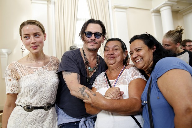 RIO DE JANEIRO, BRAZIL - SEPTEMBER 24: Johnny Depp and Amber Heard from The Hollywood Vampires attend the Starkey Hearing Foundation event to support and benefit people in need at Belmond Copacabana Palace on September 24, 2015 in Rio de Janeiro, Brazil. (Photo by Vivian Fernandez/Getty Images for Starkey Hearing Foundation)