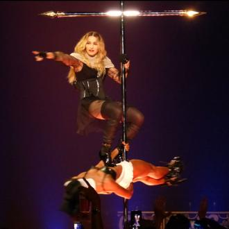 madonna_on_a_crucifix_on_her_rebel_heart_tour_1015233