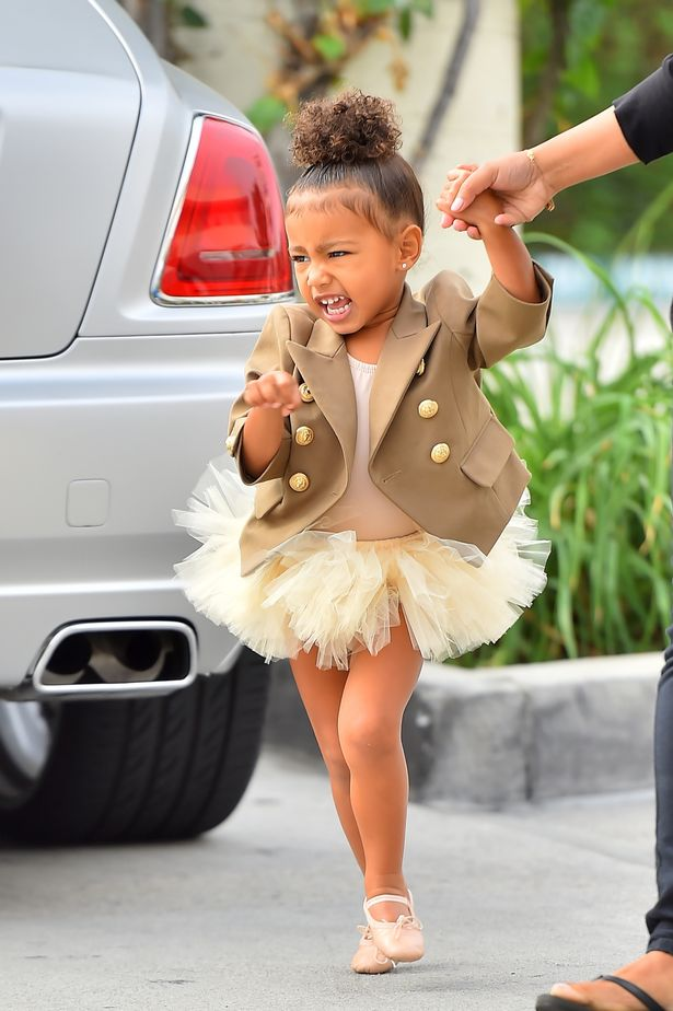 North-West-arrives-at-ballet-wearing-a-brown-coat-and-tutu