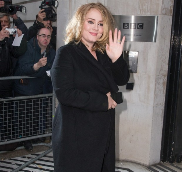 Adele pictured arriving at the Radio 2 studio to appear on the Chris Evans Breakfast Show to promote her new song, 'Hello' which is her first for 3 years Featuring: Adele Adkins Where: London, United Kingdom When: 23 Oct 2015 Credit: Mario Mitsis/WENN.com