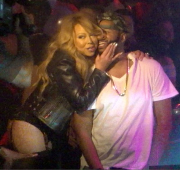 Mariah Carey has wild club night in Las Vegas while holding a glass in hand and holding with two hands onto her DJ friend as she parties the night away in her vip dj booth at 1OAK