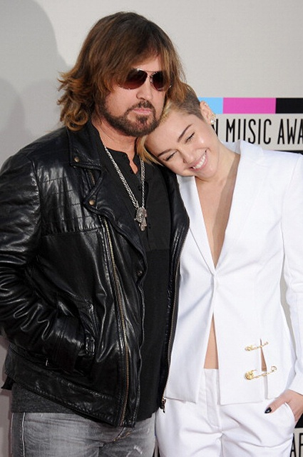 LOS ANGELES, CA - NOVEMBER 24:  Miley Cyrus and Billy Ray Cyrus arrive at the 2013 American Music Awards at Nokia Theatre L.A. Live on November 24, 2013 in Los Angeles, California.  (Photo by Gregg DeGuire/WireImage)
