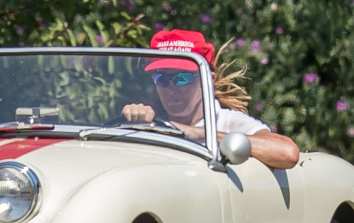 EXCLUSIVE: Caitlyn Jenner wears a red 'Make America Great Again' while cruising her classic car in Malibu