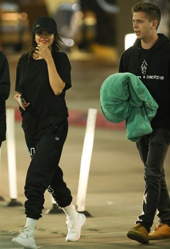 *EXCLUSIVE* Selena Gomez is all smiles during a night out with rumored beau Caleb Stevens and friends