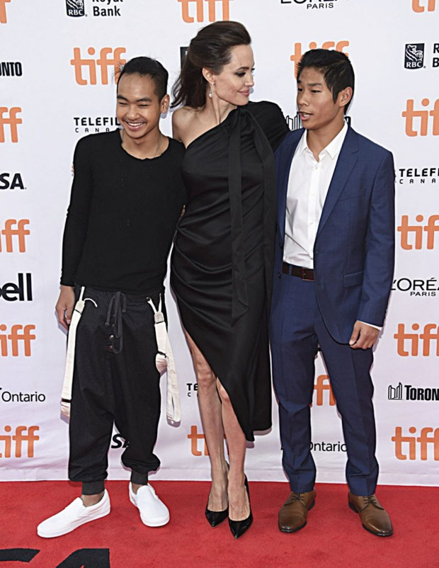 "Mandatory Credit: Photo by Invision/AP/REX/Shutterstock (9050674aa) Maddox Jolie-Pitt, Angelina Jolie, Pax Jolie-Pitt. Maddox Jolie-Pitt, from left, Angelina Jolie and Pax Jolie-Pitt attend a premiere for ""First They Killed My Father"" on day 5 of the Toronto International Film Festival at the Princess of Wales Theatre, in Toronto 2017 TIFF - ""First They Killed My Father"" Premiere, Toronto, Canada - 11 Sep 2017"
