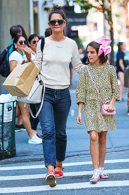 EXCLUSIVE: Katie Holmes and Suri Cruise, in a yellow polka-dot dress and pink bowtie, take a walk when shopping around New York City Pictured: Katie Holmes, Suri Cruise Ref: SPL1558023  170817   EXCLUSIVE Picture by: XactpiX/Splash News Splash News and Pictures Los Angeles:310-821-2666 New York:212-619-2666 London:870-934-2666 photodesk@splashnews.com