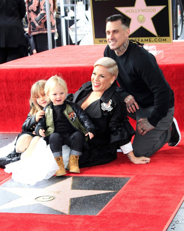 Mandatory Credit: Photo by NINA PROMMER/EPA-EFE/REX/Shutterstock (10095133o) US singer Pink sits on her star with daughter Willow Sage Hart, son Jameson Moon Hart and husband Carey Hart as she receives the 2,656th Star on the Hollywood Walk of Fame in Hollywood, California, USA, 05 February 2019. The star was dedicated in the Category of Recording. Pink receives a star on the Hollywood Walk of Fame, Los Angeles, USA - 05 Feb 2019