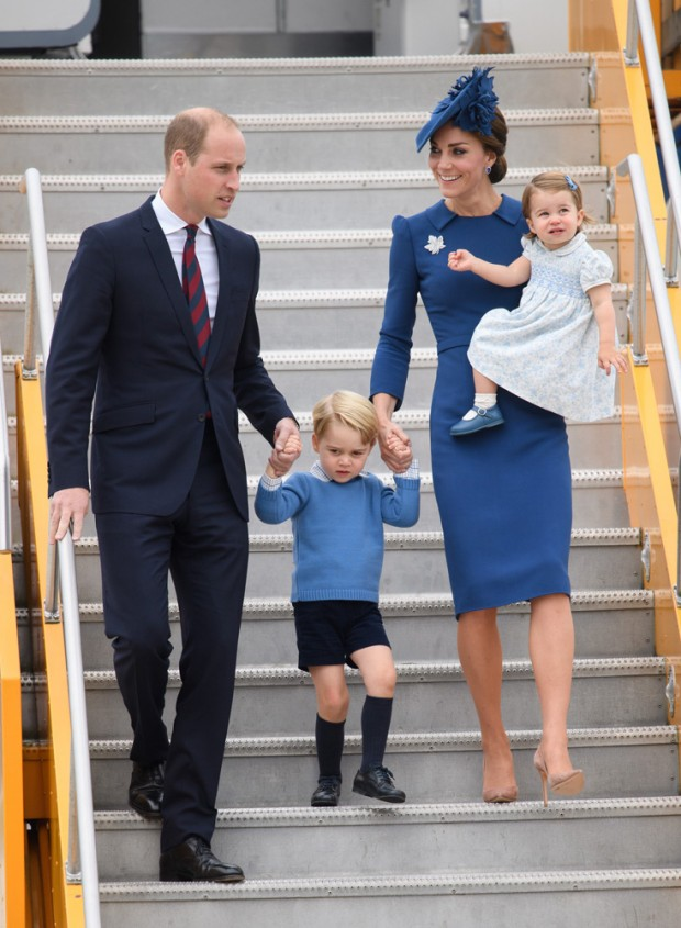 Mandatory Credit: Photo by Tim Rooke/REX/Shutterstock (6012932as) Prince William, Prince George, Catherine Duchess of Cambridge and Princess Charlotte of Cambridge -  official welcome at British Columbia Parliament buildings, Victoria The Duke and Duchess of Cambridge visit Canada - 24 Sep 2016 Hundreds of well-wishers, waving British flags and holding bouquets of flowers lined the airport route to welcome the royals. Prince William emerged from the Airbus at about 4 pm holding hands with blond-haired Prince George. The young Prince was wearing dark blue shorts with a light blue sweater. Princess Kate, wearing a blue dress and blue hat, carried Princess Charlotte in her arms. The youngest princess hugged her mother close. Her brownish hair included a blue barret. The royal couple was greeted first on the Tarmac by Governor General David Johnston and his wife. Followed by Prime Minister Justin Trudeau and his wife, Sophie Gregoire Trudeau. Also on the Tarmac was British Columbia's Lt.-Gov. Judith Guichon. B.C. Premier Christy Clark and her son, Hamish were also on the Tarmac. The welcoming ceremony was 10 minutes. Prince George waved several times during the arrival. The royals waved to well-wishers from their motorcade vehicle