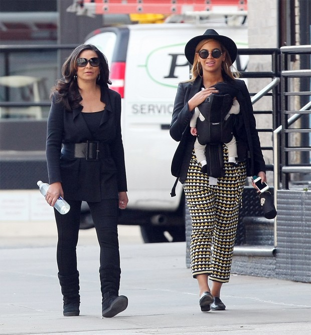 Beyonce is all smiles as she goes for a stroll on Monday afternoon with her new baby Blue Ivy Carter and mom Tina Knowles in Tribeca. Beyonce is seen holding a blue pacifier for Blue Ivy Carter.  Pictured: beyonce knowles,blue ivy carter,beyonce knowles blue ivy carter Ref: SPL369311 120312 NON-EXCLUSIVE Picture by: SplashNews.com Splash News and Pictures Los Angeles: 310-821-2666 New York: 212-619-2666 London: +44 (0)20 7644 7656 Berlin: +49 175 3764 166 photodesk@splashnews.com World Rights