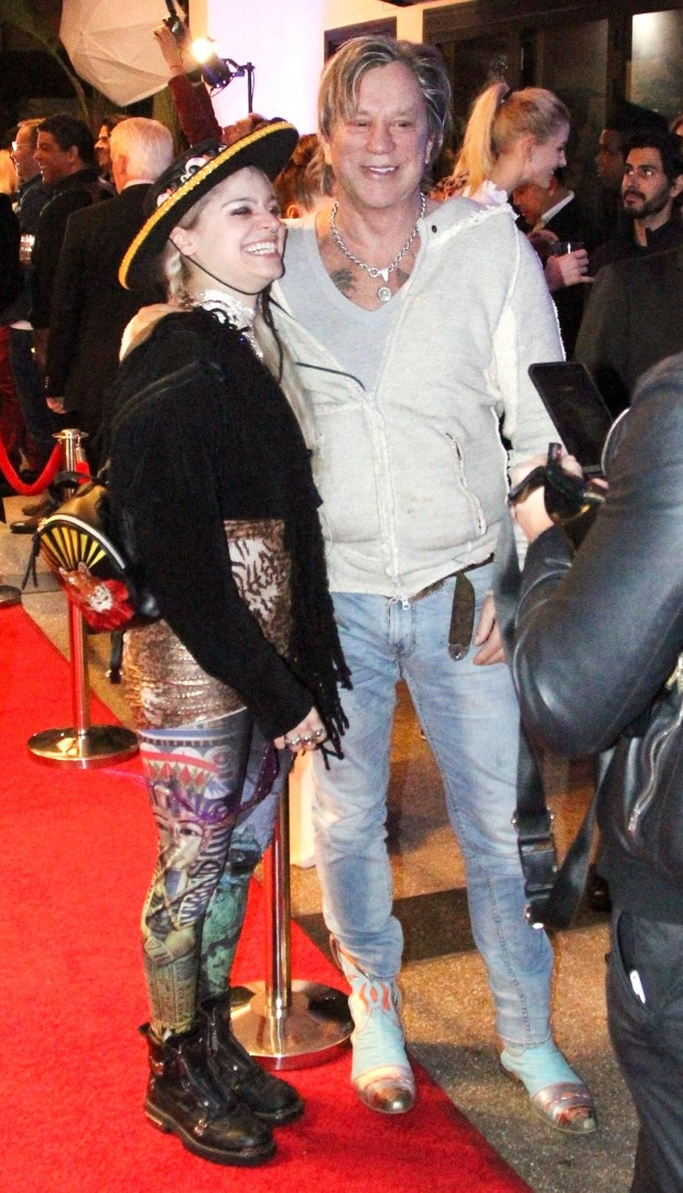 Beverly Hills, CA  - Actor Mickey Rourke, 66, was spotted attending a celebrity Christmas party at Caffe Roma in Beverly Hills. Mickey and hisRussian model girlfriend,  Anastassija Makarenko, 32,  joked around during a short interview before heading out. Pictured: Mickey Rourke, Anastassija Makarenko BACKGRID USA 16 DECEMBER 2018  BYLINE MUST READ: RC / BACKGRID USA: +1 310 798 9111 / usasales@backgrid.com UK: +44 208 344 2007 / uksales@backgrid.com *UK Clients - Pictures Containing Children Please Pixelate Face Prior To Publication*
