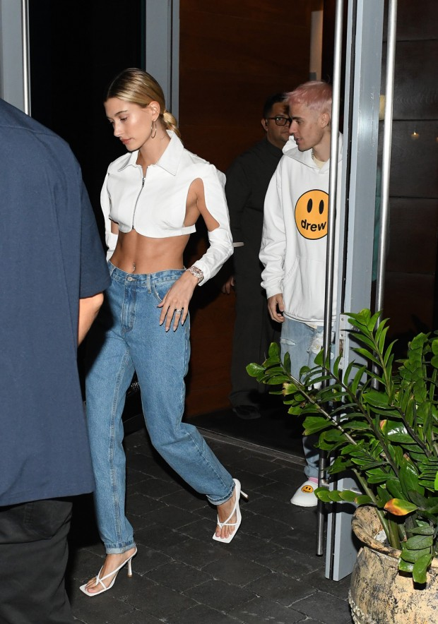 HaileyBieber wears a cutout top and diamond encrusted watch as Justin Bieber debuts pink hair on their way out to dinner