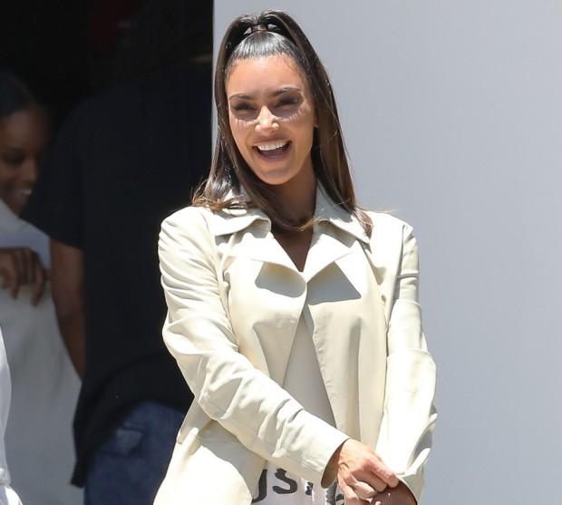 Kim Kardashian is all smiles as she takes North to Kanye's church service