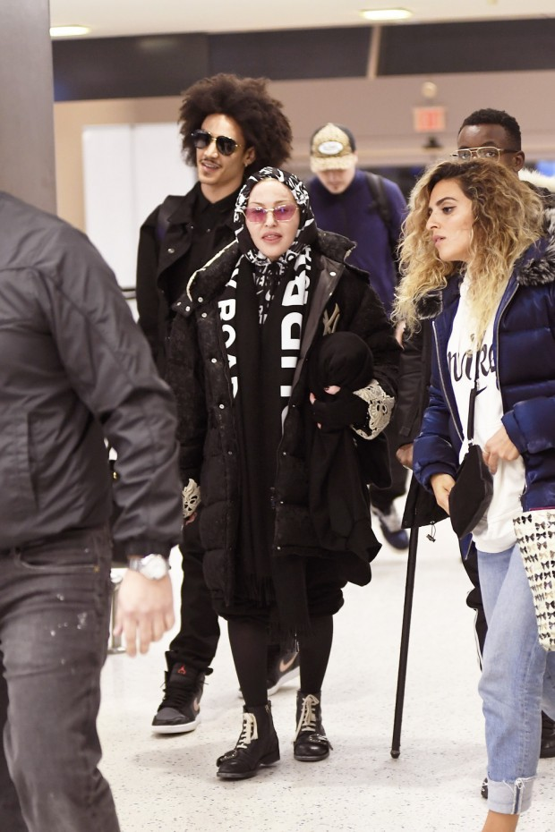Madonna And Her Boyfriend Ahlamalik And Her Kids Are Seen Arriving At JFK International Airport To Catch A Flight Out Of The City This Evening
