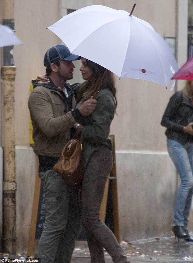 Wrapped up in each other: The PDA by a Hollywood star left passers-by stunned