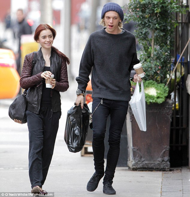 Good spirits: Lily Collins and boyfriend Jamie Campbell Bower took a stroll through Yorkville in Toronto, Canada on Monday