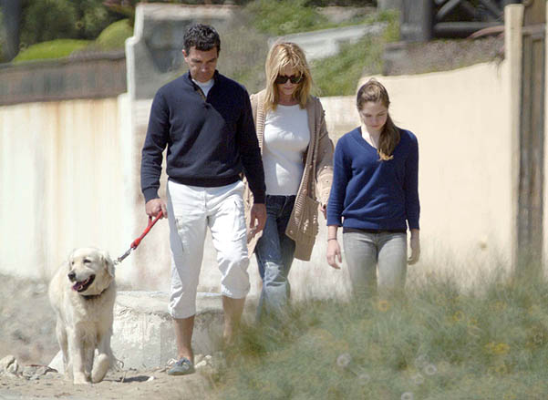 Melanie Griffith, Antonio Banderas  and  their daughter Estella del Carmen Banderas walk on the beach with the family dog during Easter holiday in Banderas' home city of Malaga Malaga, Spain - 03.04.09 **Available for publication in UK. Not for publicatio