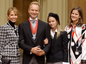 BRITAIN'S STING STANDS WITH MEMBERS OF HIS FAMILY AFTER RECEIVING HIS CBE AT BUCKINGHAM PALACE IN LONDON.