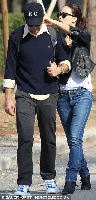 Love me tender: As they walked with their hands interlocked Olivia was seen adjusting her beau's rucksack
