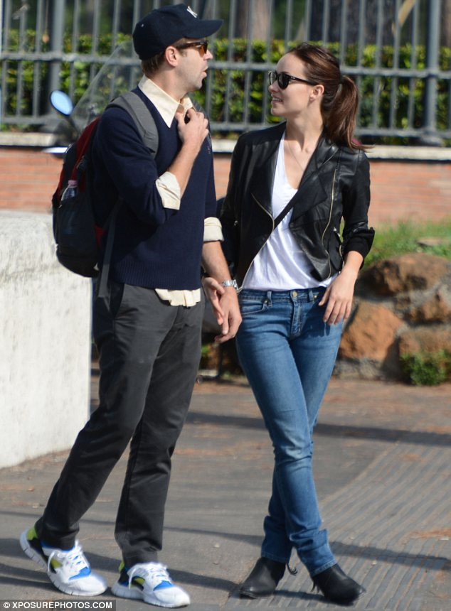 Hand in hand: The couple looked delighted to be spending some time together as Olivia took a break from filming The Third Person