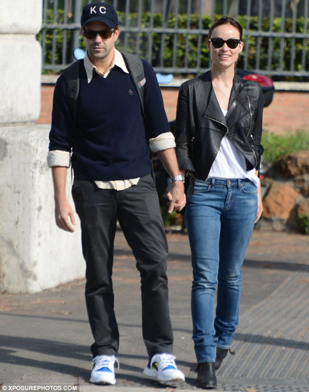 Casual couple: The loved up duo dressed down for their day out as they took an amorous stroll