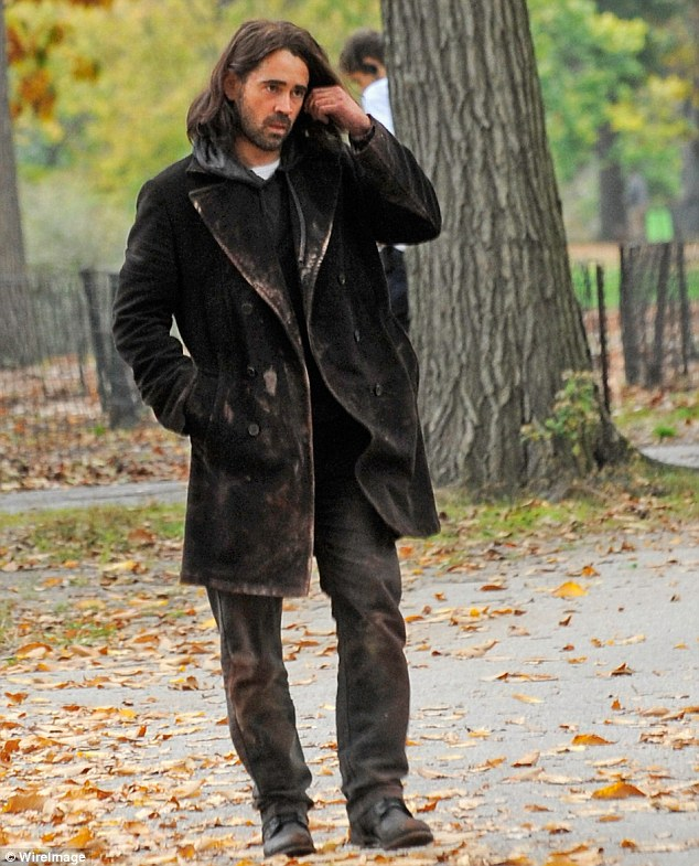 Vagrant: The Irish star appeared disheveled in a tatty brown coat and trousers with dirt on his hands