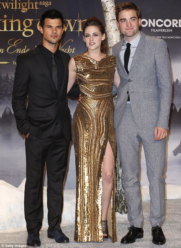 Here they come again: Kristen Stewart was joined by co-stars Robert Pattinson, right, and Taylor Lautner at the Twilight: Breaking Dawn Part 2 premiere in Berlin, Germany, on Friday