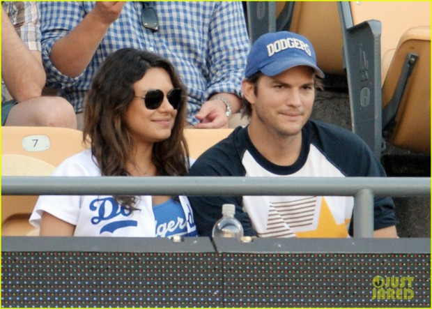 Mila Kunis and Ashton Kutcher kiss at LA Dogers v St Louis Cardinals, Los Angeles
