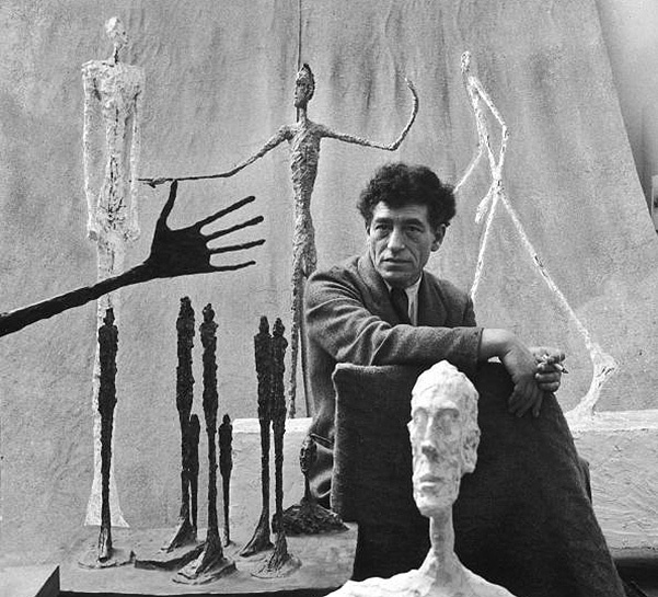 Portrait of artist Alberto Giacometti surrounded b