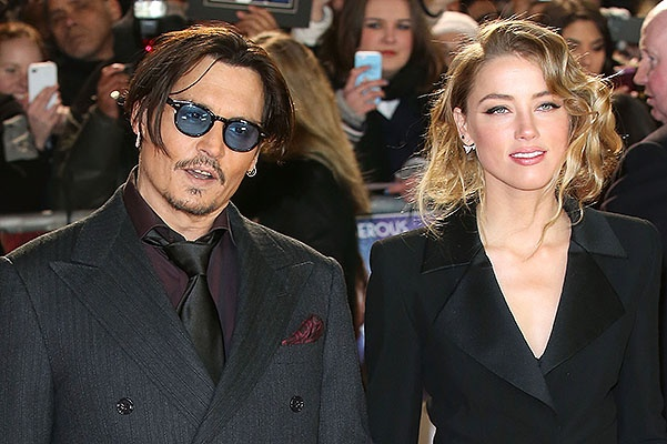 """LONDON, ENGLAND - JANUARY 19:  Actor Johnny Depp and Amber Heard attend the UK Premiere of """"Mortdecai"""" at Empire Leicester Square on January 19, 2015 in London, England.  (Photo by Tim P. Whitby/Getty Images)"""