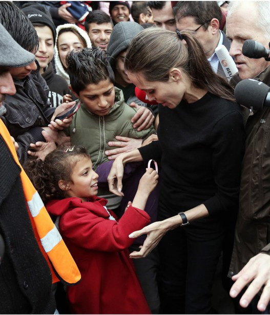 Hollywood actress Angelina Jolie has visited Pireaus port where there is a migrants' camp, near Athens, Greece Pictured: Angelina Jolie is given a bracelet as a gift a a migrant girl Ref: SPL1247154  160316   Picture by: K Baltas/Intime/Athena/Splash Splash News and Pictures Los Angeles:	310-821-2666 New York:	212-619-2666 London:	870-934-2666 photodesk@splashnews.com