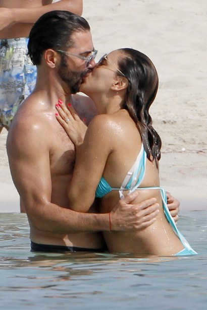 """** RESTRICTIONS: ONLY UNITED STATES ** Formentera, SPAIN - Formentera, Spain - Eva Longoria and husband Jose Baston are spotted showing a lot of PDA in a loving embrace while having fun in the water, enjoying their vacation in Spain.  Eva is looking very tan accented in her tiny blue bikini.  The couple were enjoying the company of friends including """"Prison Break"""" star Amaury Nolasco. or  Mark Satter (317) 691-9592 msatter@akmgsi.com sales@akmgsi.com www.akmgsi.com  AKM-GSI 21 JULY 2016  To License These Photos, Please Contact :  Maria Buda  (917) 242-1505  mbuda@akmgsi.com or Mark Satter  (317) 691-9592  msatter@akmgsi.com  sales@akmgsi.com"""