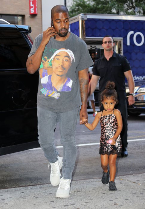 Kanye West walks North West to the puppy store and then the movie theater in New York. Pictured: Kanye West,North West Ref: SPL1342642  290816   Picture by: Jackson Lee/Splash News Splash News and Pictures Los Angeles:310-821-2666 New York:212-619-2666 London:870-934-2666 photodesk@splashnews.com