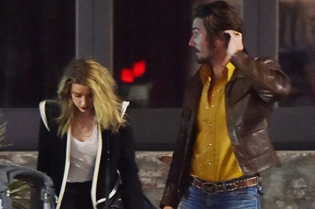 Amber Heard dines at the No Name club with a male companion