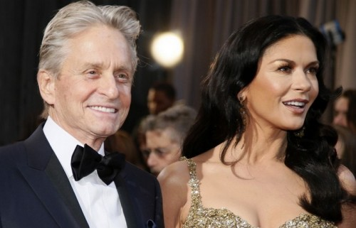 Actor, Oscars presenter Michael Douglas and his wife, actress Catherine Zeta-Jones arrive at the 85th Academy Awards in Hollywood, California