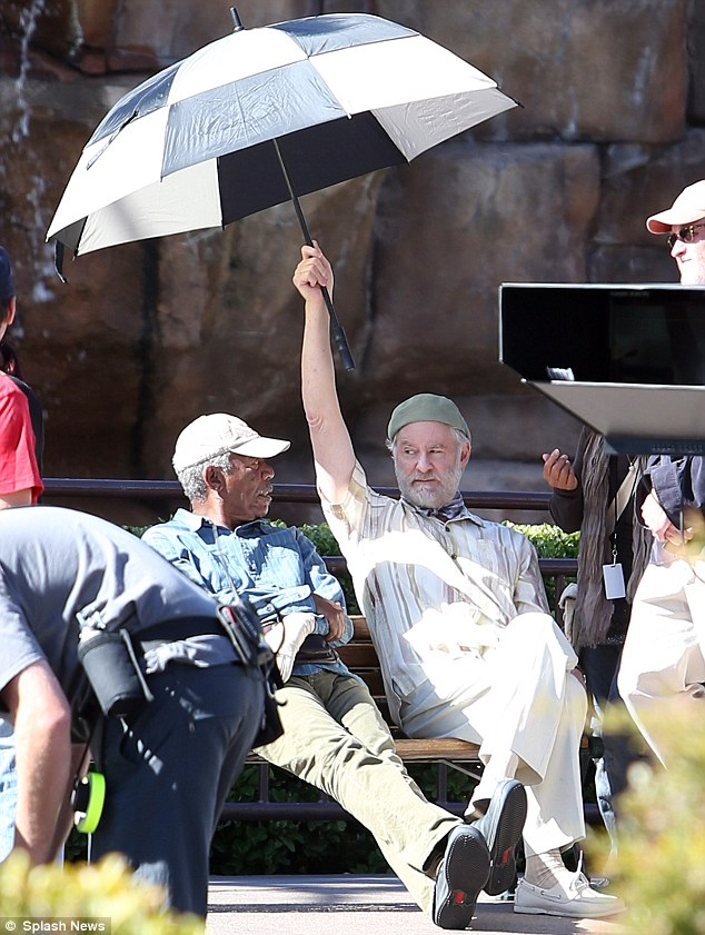 A brolly good fellow: Kevin shielded Morgan and himself from the sun as they enjoyed a spot of down time
