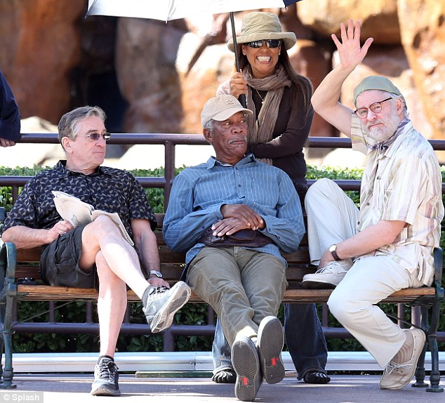 That way inKlined: Gregarious Kevin gave a friendly wave while Robert De Niro and Morgan Freeman sat stony faced on the set of Last Vegas on Thursday