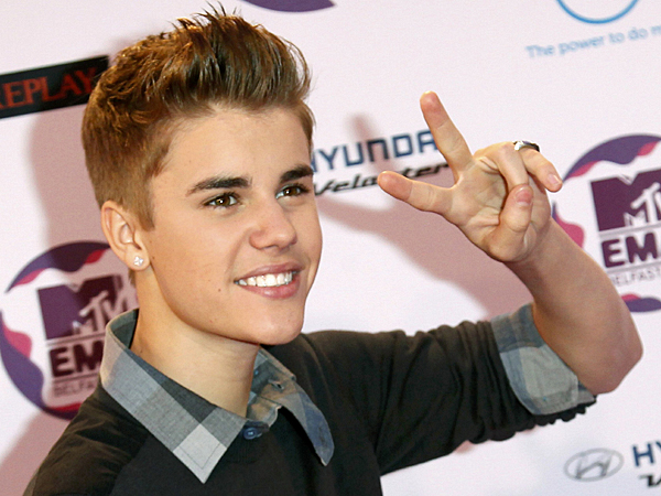 Canadian pop star Justin Bieber poses on arrival on the red carpet at the MTV Europe Music Awards show in Belfast