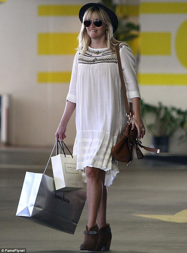 Yummy mummy: Reese Witherspoon looked effortlessly chic in a black fedora and boho-inspired dress as she stepped out in Beverly Hills, California