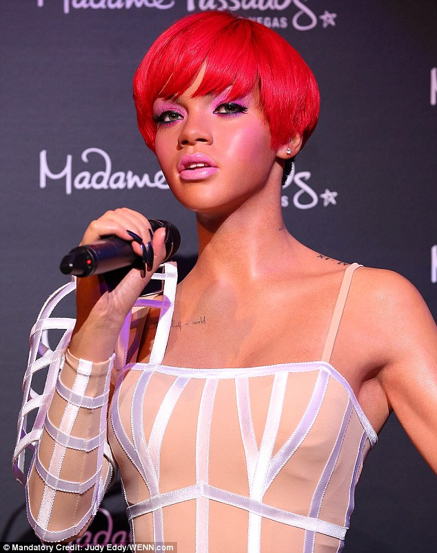 Perfect! The hitmaker's statue was uncanny up close, truly capturing Rihanna's tough yet ultra-feminine features with hot pink makeup and a shorter flame-haired wig